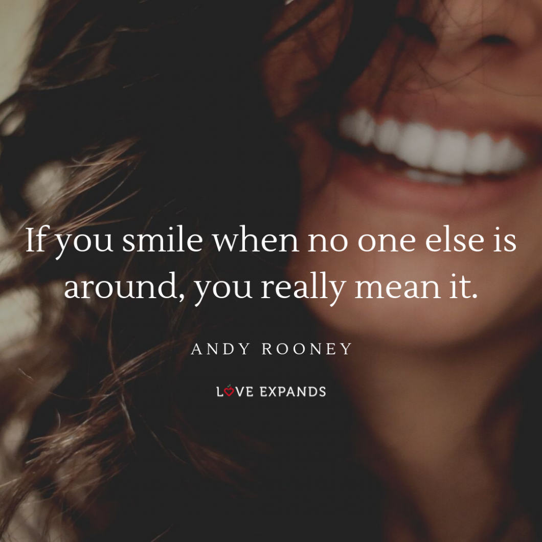 "A picture quote by Andy Rooney of a woman's beautiful smile. The quote reads, ""If you smile when no one else is around, you really mean it."""