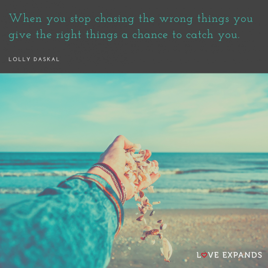 "The left hand of a woman releasing shells on the beach. Picture quote by Lolly Daskal that says, ""When you stop chasing the wrong things you give the right things a chance to catch you."""