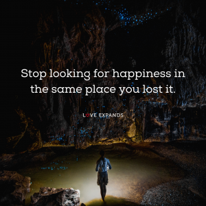 Picture quote of a young girl in a cave looking to find her lost happiness