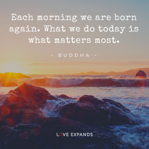 Sunrise over ocean rocks and a Buddha picture quote